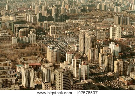 BEIJING, CHINA - APR 1: City aerial view with architecture on April 1, 2013 in Beijing, China. It is the second largest Chinese city and the nation's political, cultural, educational center.