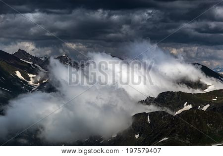 Birth of clouds high in mountains on morning. Ridge Abushura Akhuba. Caucasus mountains. Karachay-Cherkessia. Russia.