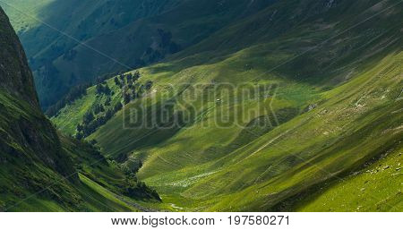 Picturesque mountain emerald valley of river Zagedanka. Caucasus mountains. Karachay-Cherkessia. Russia.