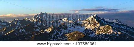 Dawn high in mountain. Mounts Zakzan-Syrt and Pshish.  Greater Caucasus Mountain Range. Karachay-Cherkessia. Russia.