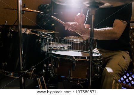 Professional drum set closeup. Musician with drums, live rock concert, drummer playing music