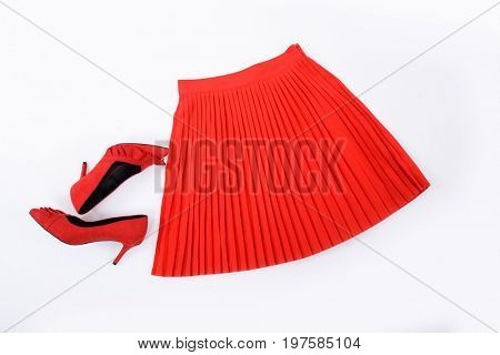 Red pleated skirt with red shoes isolated