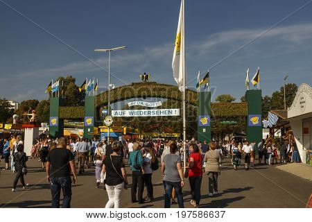 Munich, Germany - September 24, 2016: Exit gate from the Oktoberfest on the Theresienwiese in Munich with unidentified people walking by