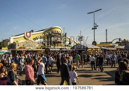 Munich Germany - September 24 2016: Facade and entrance of the Ochsenbraterei beer tent with unidentified people on the main stree passing by