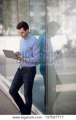 Freelancer workaholic working on street. Attentive businessman with laptop