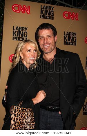 LOS ANGELES - DEC 16:  Tony Robbins & wife arrives at CNN's 'Larry King Live' final broadcast party at Spago on December 16, 2010 in Beverly HIlls, CA.