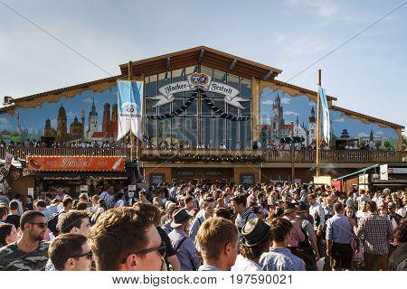 Munich, Germany - September 24, 2016: Facade of the Hacker Festzelt (Himmel der Bayern) at Oktoberfest with people in front