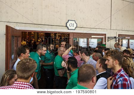 Munich, Germany - September 24, 2016: Closed entrance of the Winzerer Faehndl beer tent with bouncers and unidentified people waiting in front