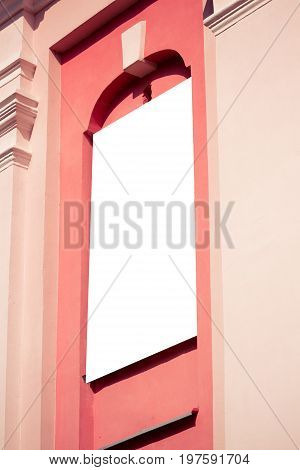 Mock up. Blank vertical billboard outdoors, outdoor advertising board on classical architecture building wall