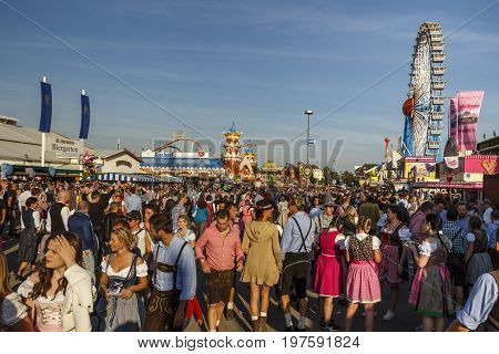 Munich, Germany - September 24, 2016: Main street on Theresienwiese fairground with large beer tents and sales stalls