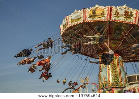 Munich, Germany - September 24, 2016: Carousel in motion with people flying through the air on Theresienwiese