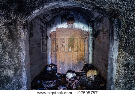 Opened rusty armored hermetic door, entrance to abandoned Soviet warship ammunition depot under Sevastopol
