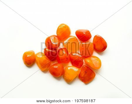 Tumbled Carnelian Stones On White Background For Crystal Therapy Treatments And Reiki
