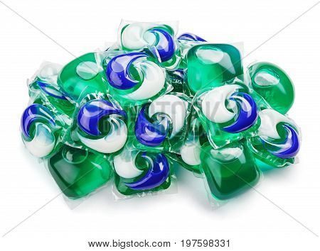 Pile of washing gel capsule pods with laundry detergent isolated on white background with clipping path