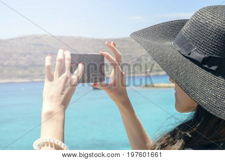 Woman Traveler Makes A Self In The Background Beautiful Natural View Mountain On The Island. Concept