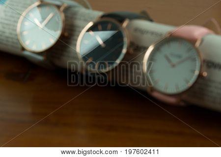 Blurr defocus of wrist watch collection on a wooden background