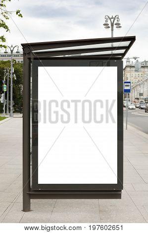 Blank advertising billboard mockup in bus stop.