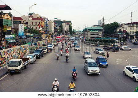 Hanoi, Vietnam - May 24, 2017: People On Motorbikes On The Hanoi Ceramic Road Shot From The Long Bie