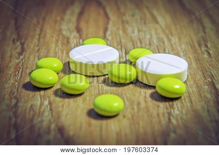 pills tablets yellow and white macro. Pharmaceuticals, chemistry, medicine. Treat disease with pills. course of treatment.