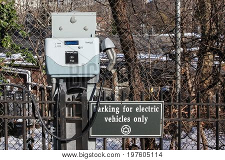 NEW YORK _ FEBRUARY: Parking place for electric vehicles in Central Park in New York City, USA on February 18, 2015