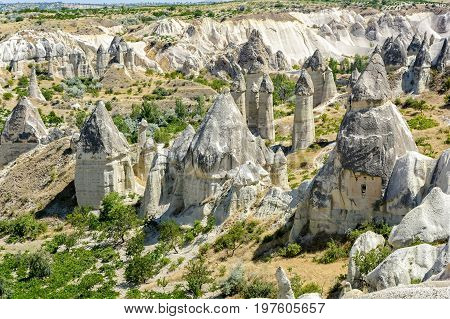Famous geological formations known as Love Valley and used as housing in Goreme Cappadocia Turkey