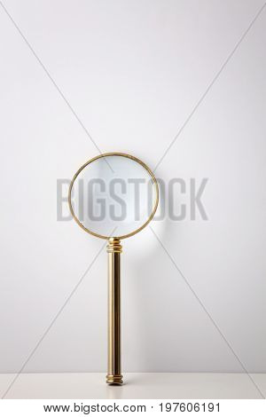 low scale magnifier glass on the white background