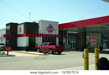HOLLAND, MICHIGAN / UNITED STATES - MAY 22, 2017: One may eat roast beef sandwiches at the Arby's Restaurant in the Pilot Travel Center.