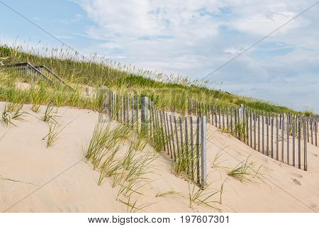 A staircase leading to the beach with sand fences in Nags Head, North Carolina.