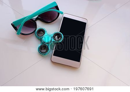 Spinner, sunglasses for the phone, spend the summer holidays. Modern toy for hands