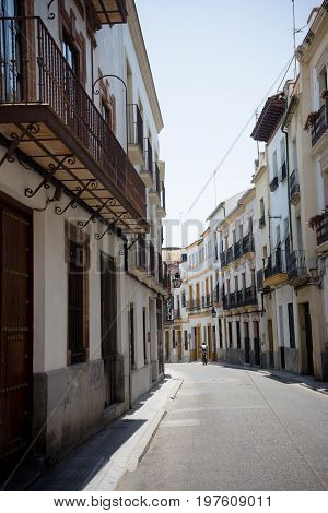 Cordoba, Spain - June 20 : A Lone Person Walking On The Streets Of Cordoba On June 20, 2017.