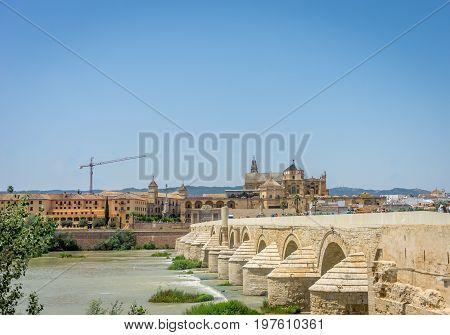 The Roman Bridge And The Mosque Church Of Cordoba Across The Guadalquivir River, Spain, Europe, Anda
