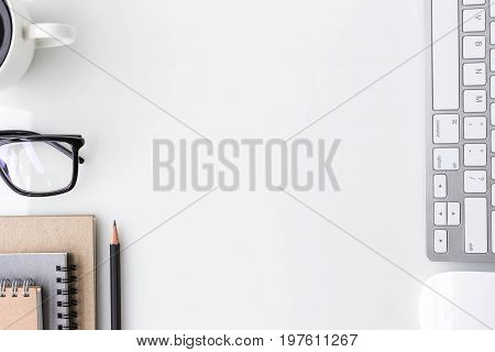 Modern white office desk top table with computer laptop notebook and other supplies. Top view with copy space on white background. Top view flat lay.