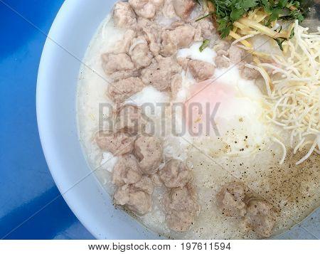 Traditional Thai Porridge Rice Gruel In White Bowl, Congee. In The Street Night Market.