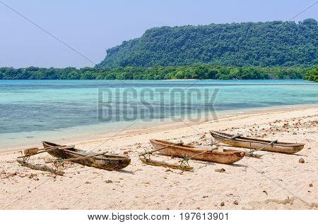 Outrigger canoes in the bay at Port Olry - Espititu Santo Vanuatu
