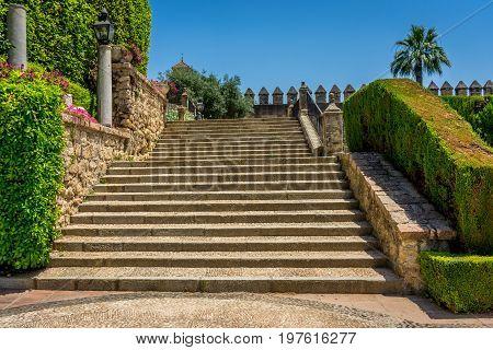 Spanish Steps In Royal Gardens Of The Alcazar De Los Reyes Cristianos Castle In Cordoba, Spain, Euro