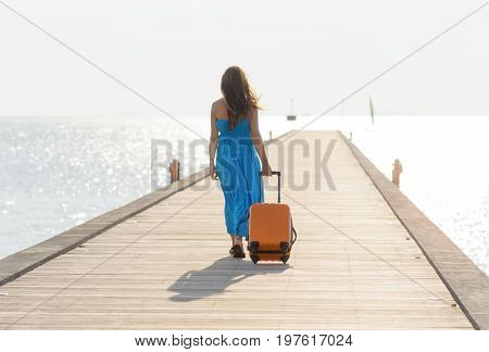 Young Woman Walking On Wooden Pier