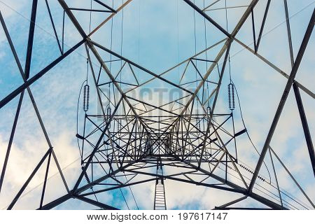 High voltage towers and transmission line for electricity.