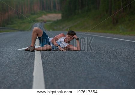 Man laying on the beauty road in mountain