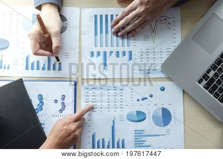 Two Business man or accountant working Financial investment writing report Analyze business and market growth and pointing on financial document data graph Accounting Economic commercialtop view