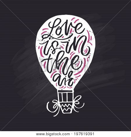 Air balloon with lettering inside. Love is in the air - classical romantic saying.