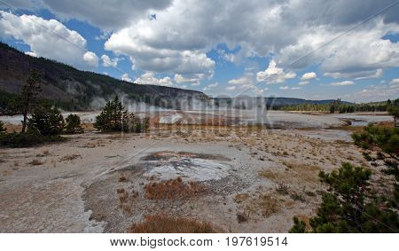 Black Sand Geyser Basin under gray clouds in Yellowstone National Park in Wyoming USA