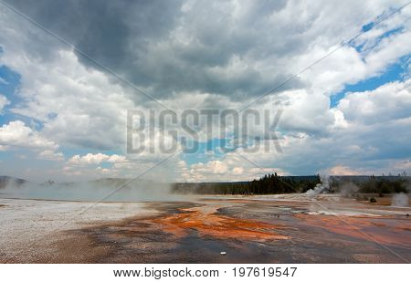 Black Sand Geyser Basin under cumulus clouds in Yellowstone National Park in Wyoming United States