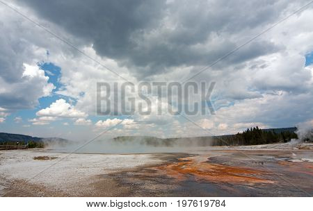 Black Sand Geyser Basin under gray cloudscape in Yellowstone National Park in Wyoming USA