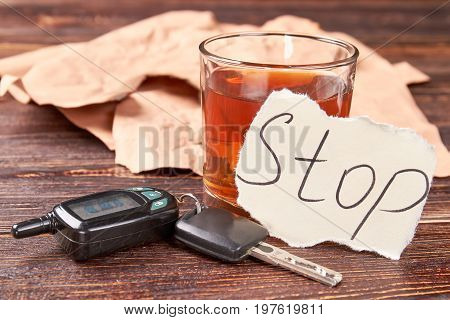 Car keys and alcohol. Stop drink alcohol beverage concept.