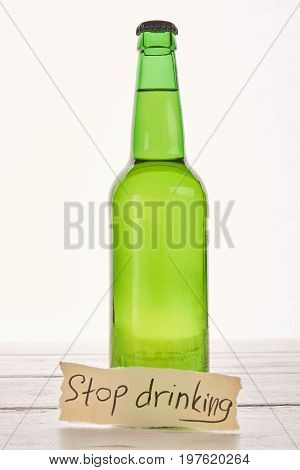 Anti alcoholism concept, wooden background. stop drinking alcohol beverage and start new life.