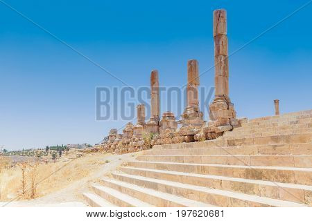 The ancient Roman city in Jerach Jordan. Huge stairways to the Temple of the Artemis in summer time blue sky background.