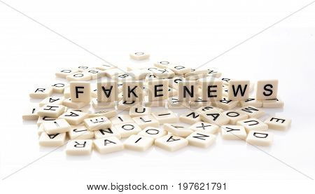 Fake News spelt out on word tiles on a white background.