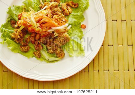 crispy fried chop catfish with green mango dressing sweet and sour sauce salad