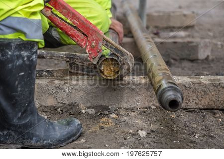 Rig Workers At Site Take Out Drill Core Sample