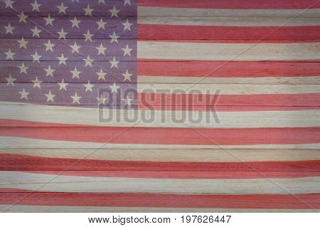 A faded American Flag superimposed on wood.